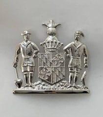 hat badge Maryland crest