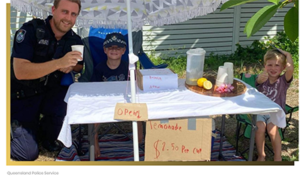 cop helps kids with lemonade stand