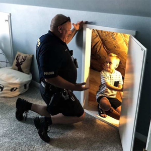 cop inspects child's room for monsters